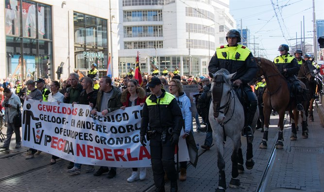 Demonstrators protesting against the arrival of Muslim immigrants to Europe in The Hague