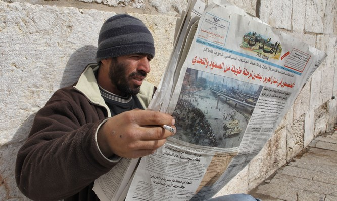 Arab reading newspaper, Old City, Jerusalem