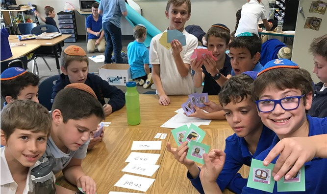 Fourth graders at Yeshivat Noam in Paramus, N.J., play a game involving characte