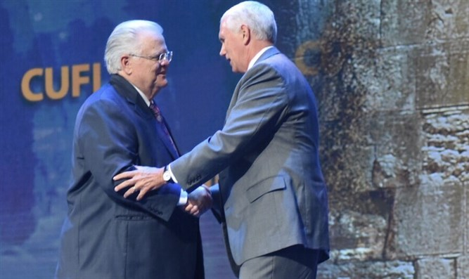 Pastor John Hagee shaking hands with Vice President Mike Pence