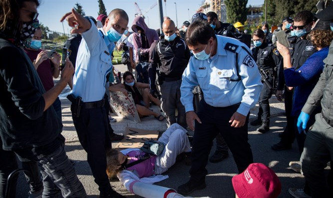 Demonstrators protest outside of the Knesset
