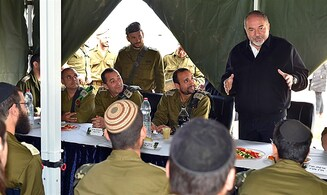 Defense Minister visits haredi soldiers, backs Kfir commander