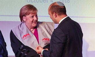 Bennett on Merkel: A true friend of Israel