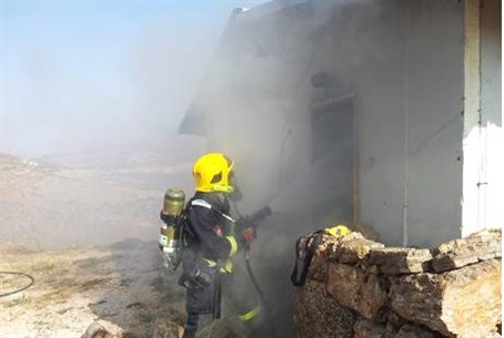 A firefighter battles a blaze