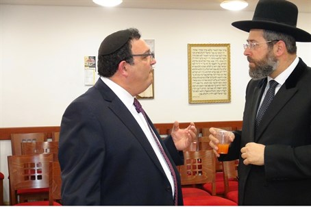 Rabbis David Lau (right) and Shai Piron