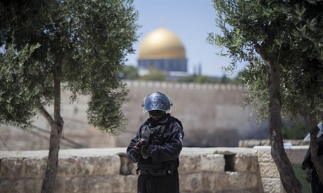 Police officer stands guard near Temple Mount