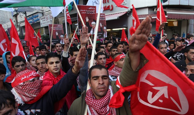 PFLP supporters do the Nazi salute