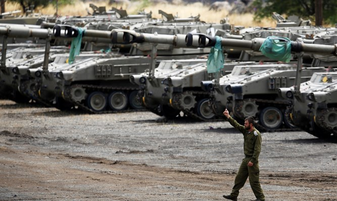 IDF mobile artillery units stand to on the Golan