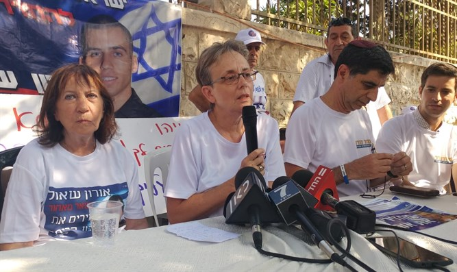 The Shaul and Goldin families outside PM Netanyahu's residence