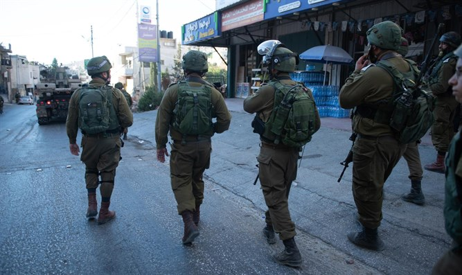 IDF soldiers search for terrorists behind Friday's bombing attack