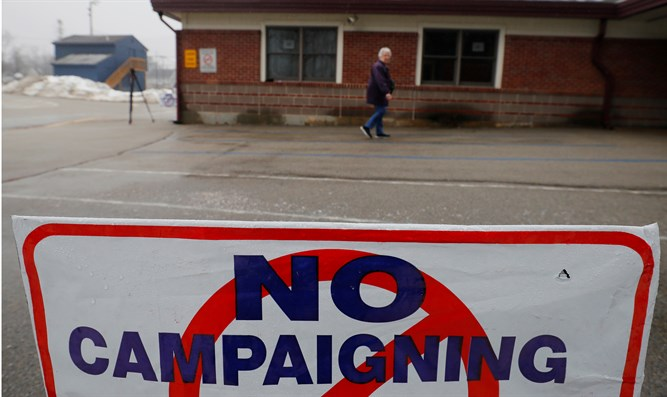 Voter arrives at polling site in New Hampshire primary