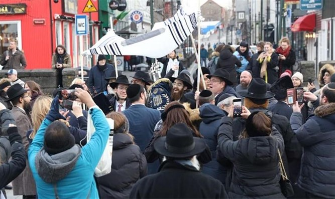 Members of Reykjavik's Jewish community dance at the dedication of their new Torah scroll