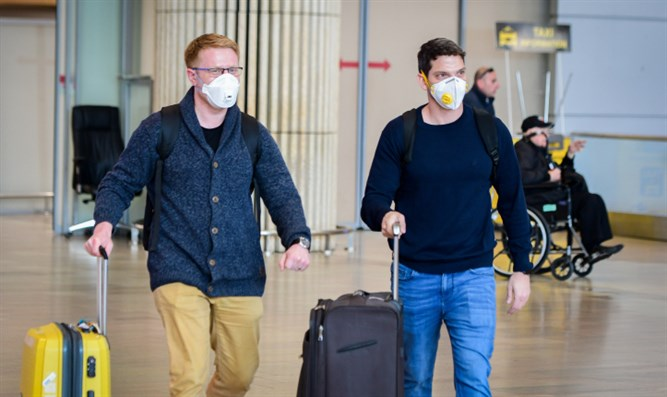 People wearing face masks for fear of the coronavirus at Ben Gurion Airport