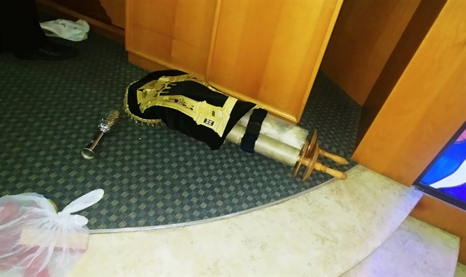 One of the Torah scrolls found thrown to the floor